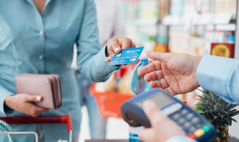 A woman making a purchase with a credit card