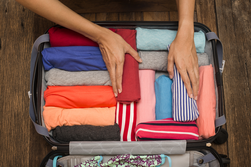 Clothes that have been rolled up to be packed into a suitcase