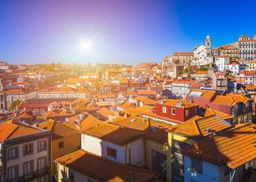 Aerial panoramic view of orange rooftops and historical buildings of the old city of Porto, Portugal