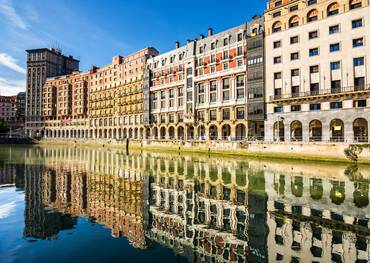 reflections at downtown bilbao facades